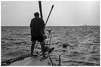Sailor getting ready to hook mooring buoy near Loggerhead Key. Dry Tortugas National Park ( black and white)