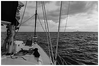 Loggerhead lighthouse seen from sailboat under dark skies. Dry Tortugas National Park ( black and white)