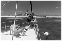 Sailors hooking mooring buoy at Loggerhead Key. Dry Tortugas National Park ( black and white)