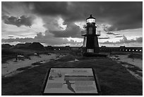 Interpretive sign, Harbor Light, and fort Jefferson. Dry Tortugas National Park ( black and white)