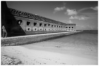 Park visitor looking, North Beach and Fort Jefferson. Dry Tortugas National Park ( black and white)