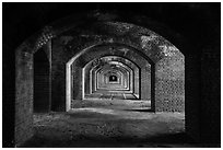 Gallery illuminated by last light inside Fort Jefferson. Dry Tortugas National Park ( black and white)