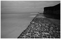 Brick seawall at dusk during a storm. Dry Tortugas National Park ( black and white)