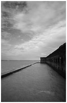 Sky, seawall and moat on windy day. Dry Tortugas National Park ( black and white)