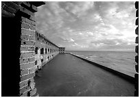 Fort Jefferson wall and moat, framed by cannon window. Dry Tortugas National Park ( black and white)