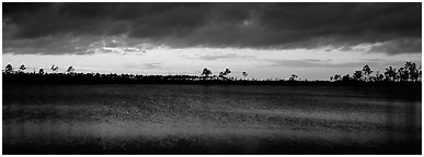 Sunset over lake with dark clouds. Everglades  National Park (Panoramic black and white)