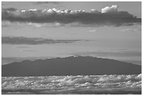 Mauna Kea and clouds at sunrise. Haleakala National Park, Hawaii, USA. (black and white)