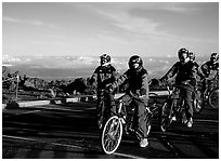 Getting ready to ride bicycles down from the top of the Crater to sea level. Haleakala National Park, Hawaii, USA. (black and white)