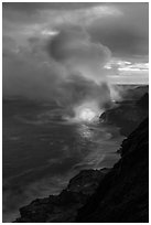 Coastline with steam illuminated by molten lava. Hawaii Volcanoes National Park ( black and white)