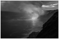 Coastline with steam lit by hot lava. Hawaii Volcanoes National Park ( black and white)