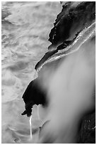 Ribbons of lava flow into the Pacific Ocean. Hawaii Volcanoes National Park ( black and white)