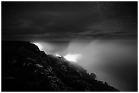 Lava makes contact with ocean on a stary night. Hawaii Volcanoes National Park ( black and white)