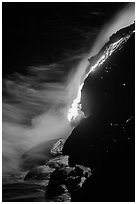 Lava flow entering Pacific Ocean at night. Hawaii Volcanoes National Park ( black and white)