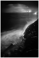 Lava ocean entry at night. Hawaii Volcanoes National Park ( black and white)