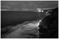 Lava reaching ocean at dawn. Hawaii Volcanoes National Park ( black and white)