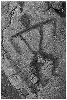 Close-up of anthropomorph petroglyph. Hawaii Volcanoes National Park, Hawaii, USA. (black and white)