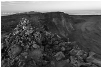 Summit cairn and crater at dusk. Hawaii Volcanoes National Park, Hawaii, USA. (black and white)