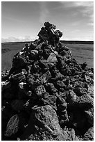 Mauna Loa summit cairn festoned with ritual offerings. Hawaii Volcanoes National Park, Hawaii, USA. (black and white)