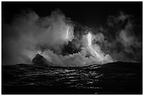 Lava cascades lighting ocean at night. Hawaii Volcanoes National Park ( black and white)