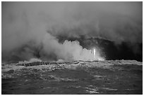 Lava flows creating huge clouds of hydrochloric steam upon meeting with ocean. Hawaii Volcanoes National Park ( black and white)
