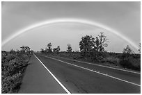 Rainbow over highway. Hawaii Volcanoes National Park ( black and white)