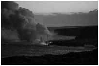 Coastline with ocean entry, sunset. Hawaii Volcanoes National Park ( black and white)