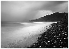 Coastline with dark rocks, light water and storm sky at sunrise, Vatia bay, Tutuila Island. National Park of American Samoa (black and white)