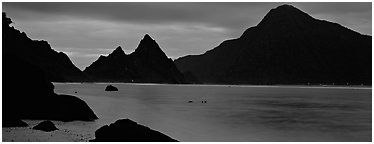Bay with coastal peaks at dusk. National Park of American Samoa (Panoramic black and white)
