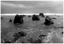 Boulders and approaching tropical storm, Siu Point, Tau Island. National Park of American Samoa (black and white)