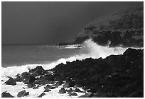 Dark boulders, crashing waves, and dark sky, storm light, Tau Island. National Park of American Samoa (black and white)