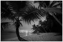 Salomon beach with distant lights at night. Virgin Islands National Park ( black and white)