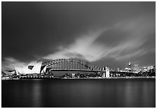 Opera House and Harbor Bridge at night. Sydney, New South Wales, Australia (black and white)