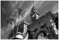 South Brisbane Town Hall, a red brick building with an ornate clock tower and archway. Brisbane, Queensland, Australia (black and white)