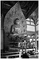 Amida seated on a lotus flower, the largest Buddha statue carved in over 900 years, Byodo-In Temple. Oahu island, Hawaii, USA ( black and white)
