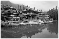 Byodo-In temple reflected in pond on a cloudy day. Oahu island, Hawaii, USA ( black and white)