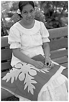Woman making a traditional hawaiian quilt. Polynesian Cultural Center, Oahu island, Hawaii, USA (black and white)