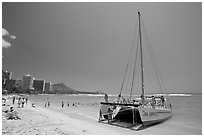 Catamaran and Waikiki Beach. Waikiki, Honolulu, Oahu island, Hawaii, USA (black and white)