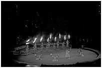 Wedding procession led by torch bearers performed by Tahitian dancers. Polynesian Cultural Center, Oahu island, Hawaii, USA (black and white)