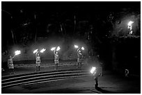 Dance with fire performed by Samoans. Polynesian Cultural Center, Oahu island, Hawaii, USA (black and white)