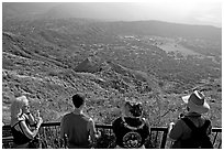 Tourists look at the  Diamond Head crater, early morning. Oahu island, Hawaii, USA (black and white)