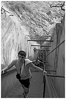 Tourist climbing a staircase on the Diamond Head summit trail. Oahu island, Hawaii, USA (black and white)