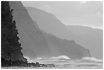 Na Pali Coast and surf seen from Kee Beach, sunset. Kauai island, Hawaii, USA (black and white)