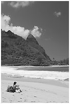 Woman sitting on a beach chair on Tunnels Beach. North shore, Kauai island, Hawaii, USA ( black and white)