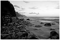 Boulders, waves, and Na Pali Coast, sunset. North shore, Kauai island, Hawaii, USA ( black and white)