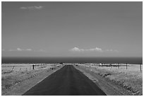 Road and Pacific Ocean, South Point. Big Island, Hawaii, USA ( black and white)