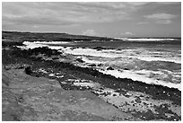Colorful shale and ocean with surf, South Point. Big Island, Hawaii, USA ( black and white)