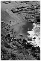 Beachgoers and green sand beach near South Point. Big Island, Hawaii, USA ( black and white)