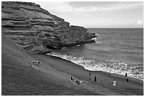 People on Mahana (green sand) Beach. Big Island, Hawaii, USA ( black and white)