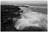 Surf and lava shoreline at sunset, South Point. Big Island, Hawaii, USA ( black and white)