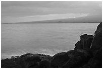 Lava rock shore and Mauna Loa shield profile from South Point. Big Island, Hawaii, USA ( black and white)